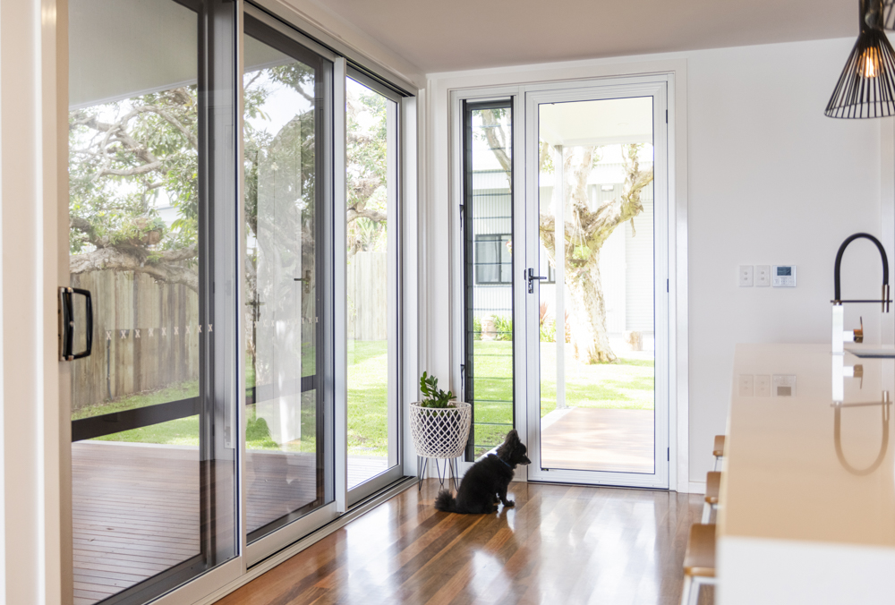 549 Series Internal Hinged Aluminium Door with Louvre Sidelight. And dog...